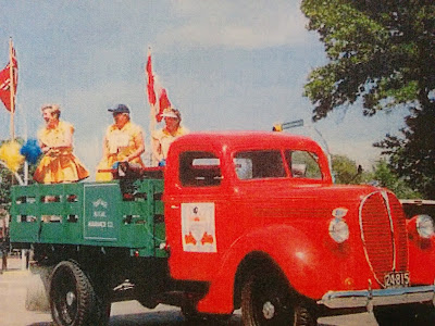 Red and green truck in a parade