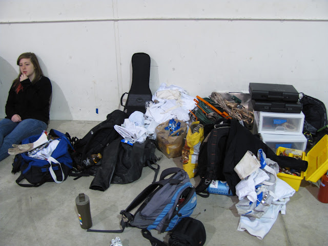 A pile of luggage and instruments