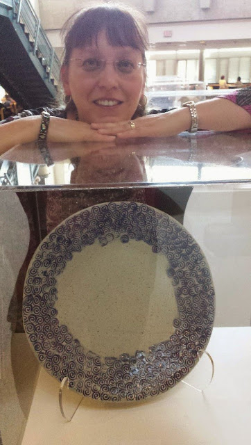 Lily with her slab built pottery ceramic platter with swirly hand stamped pattern.