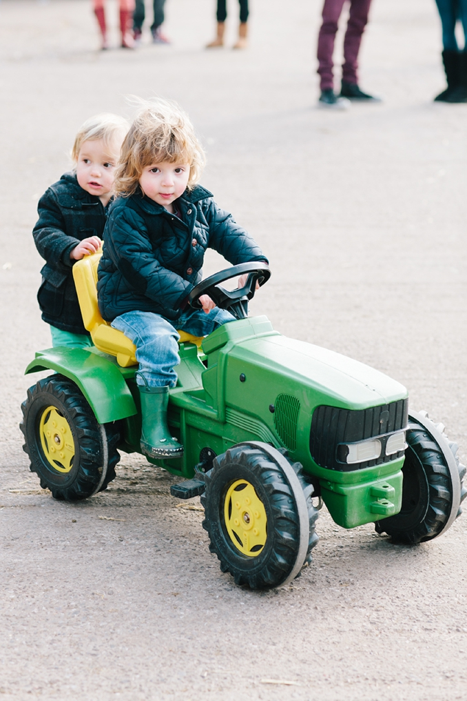adorable little boys at the farm on a tractor photo by STUDIO 1208