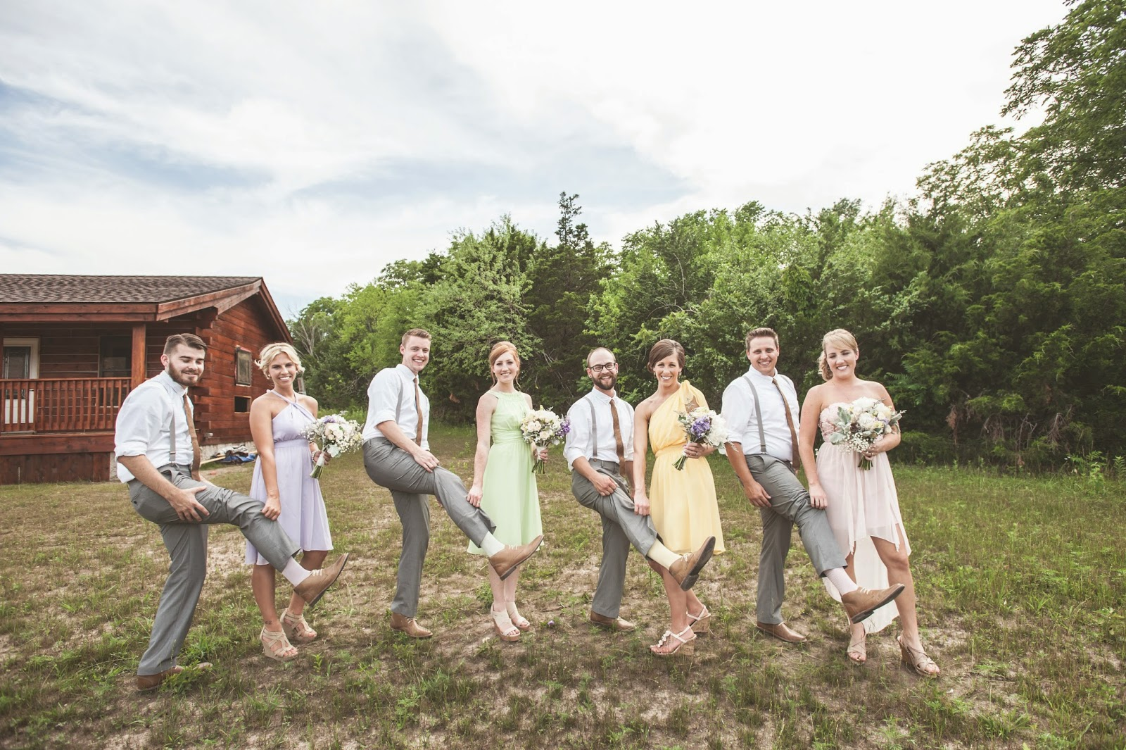 mismatched bridesmaid dresses and color coordinated groomsmen socks