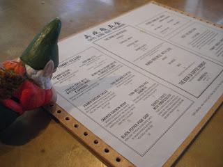 Noam reading the menu at Chye Seng Huat Hardware