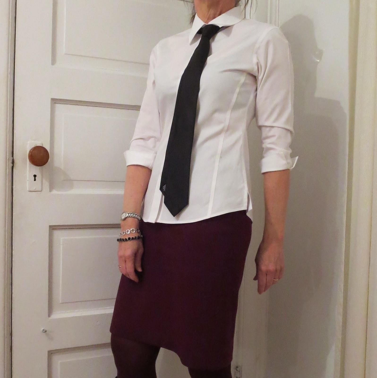 black tie and white shirt