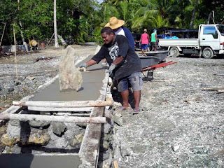 sea wall being rebuilt by yapese locals - Courtesy of 4.bp.blogspot.com