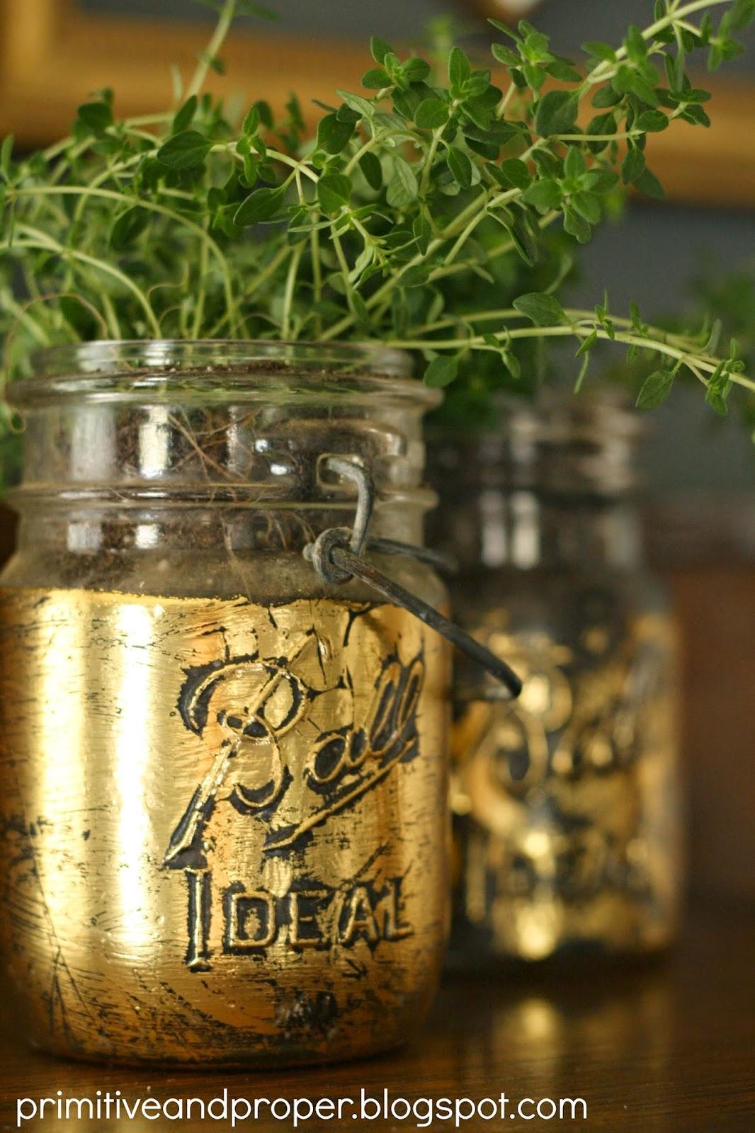 http://primitiveandproper.blogspot.com/2014/04/gold-leaf-mason-jar-planters-spring.html