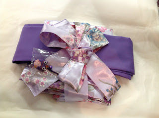 Kimono wrapped up as a gift with obi from Kimono House NY