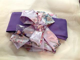 Kimono wrapped up as a gift with obi from Kimono House NY