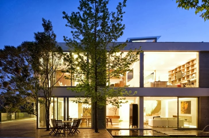 Facade of Modern dream home by Paz Arquitectura at night