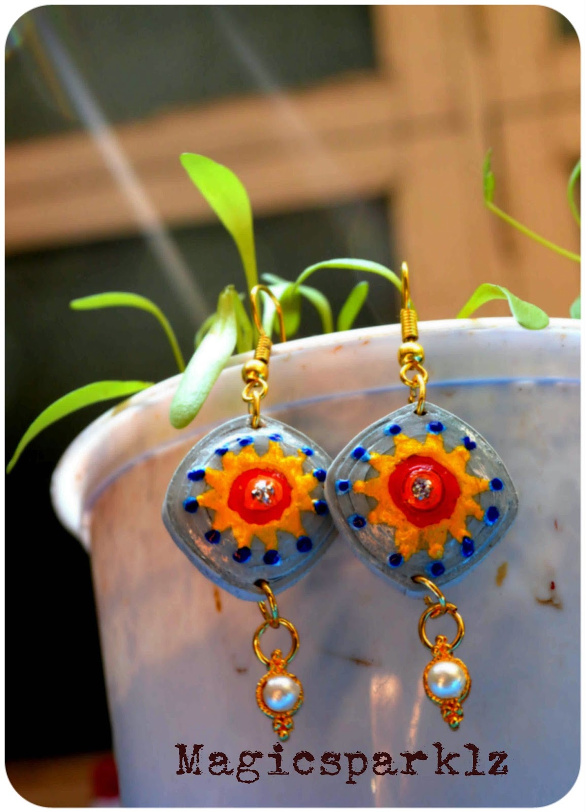 Painted blue quilled earrings