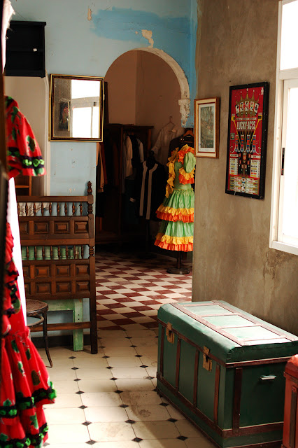 dress for sale interior of flea market in Spain - Photograph by Tim Irving