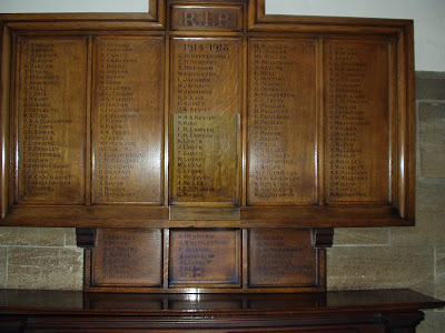 A wooden board bearing 160 names in five main panels with a smaller board below as if added later.  The top of the board reads RIP 1914-1918
