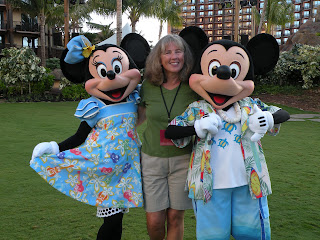 Janie with Mickey & Minnie at Disney's Aulani Resort & Spa in Oahu, Hawaii. Photograph by Janie Robinson, Travel Writer