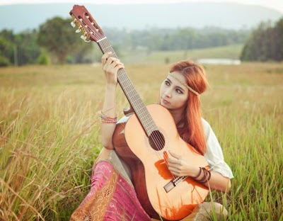 Girl on Guitar outdoors