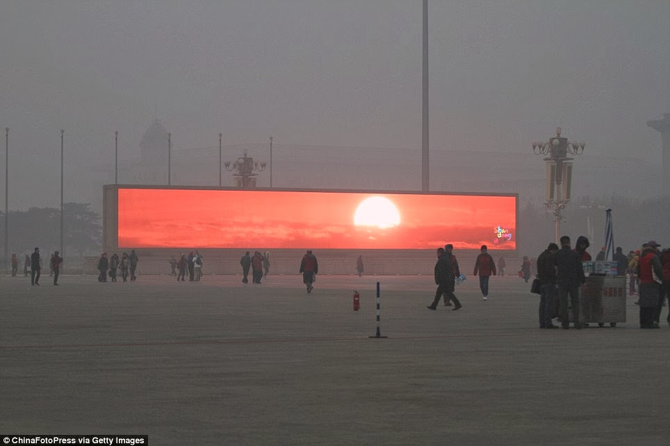 Beijing Residents Watch Sunrise On Giant Commercial Screens