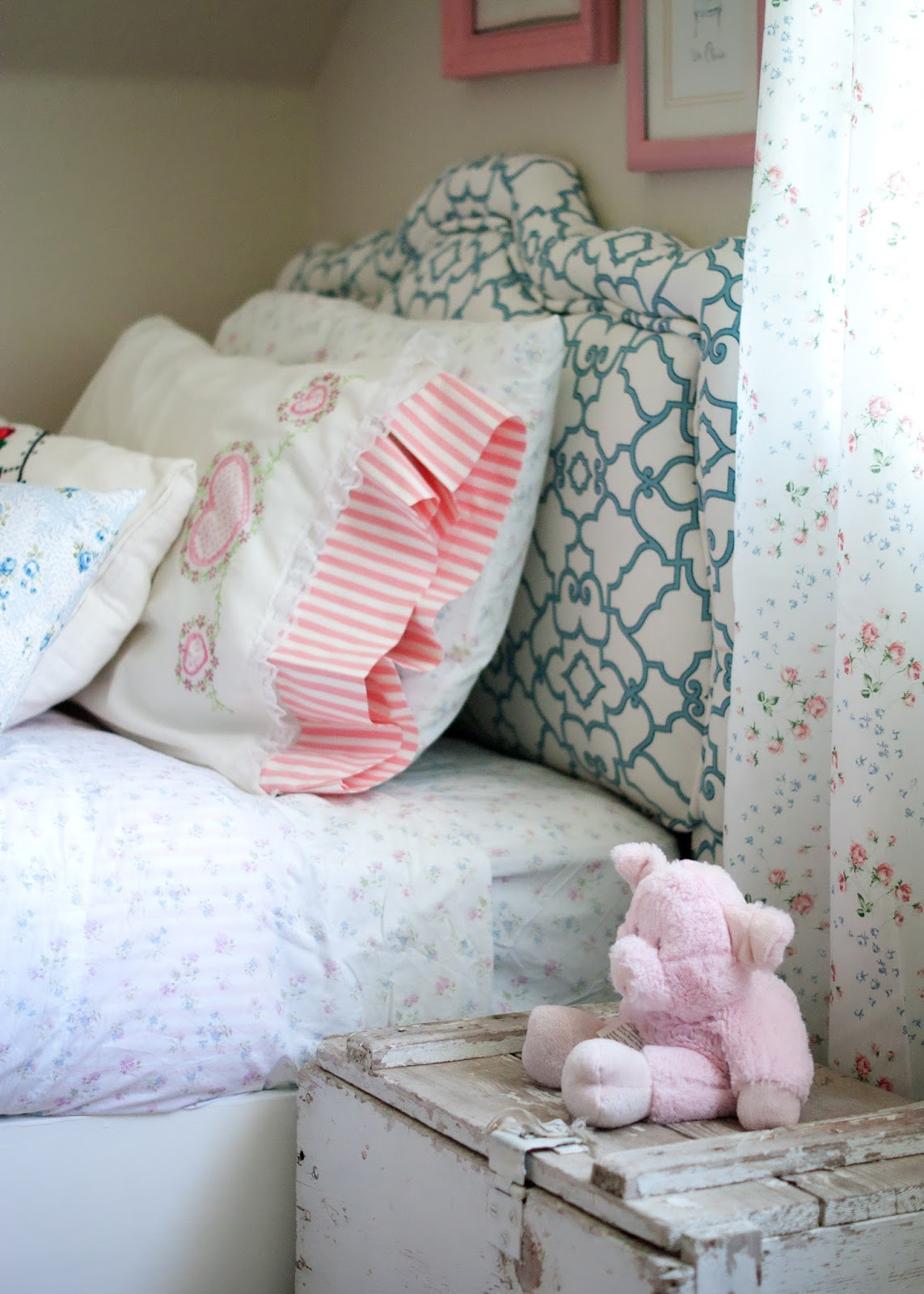 Recovered vintage headboard, DIY bed, vintage linens and old toolbox