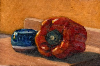 Oil painting of a blue and white glazed terracotta pot beside a red pepper, both sitting on a wooden chopping board and illuminated by the afternoon sunshine.