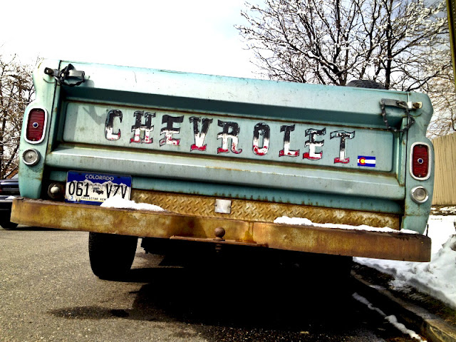 A cool old Chrevrolet pickup truck parked in a neighborhood near downtown Denver.