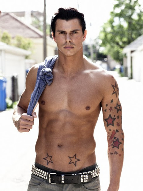 Kenny Braasch shirtless with star tattoos