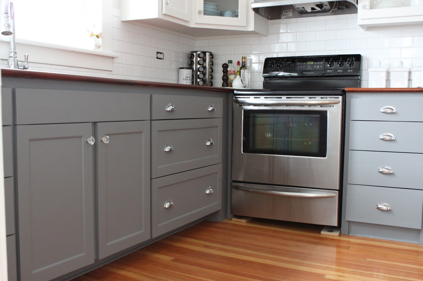 Modern jane two tone cabinets reveal for Painting kitchen cabinets