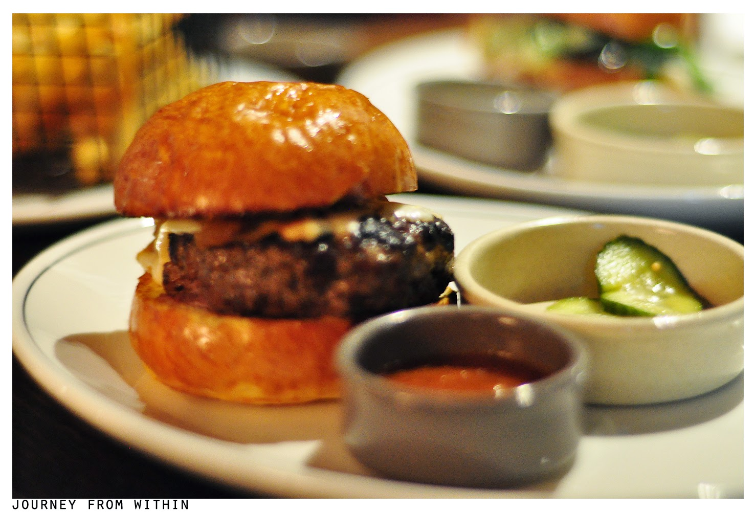 Dry aged beef burger with caramelised onions & fontina
