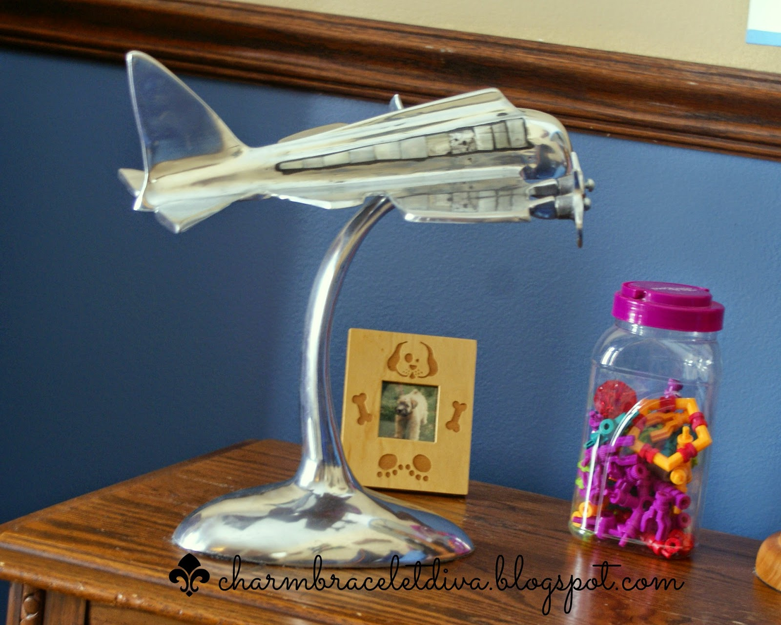 silver aluminum desk top airplane model on a bedside table