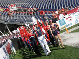 Me marching onto the football field with the USA Marching Band