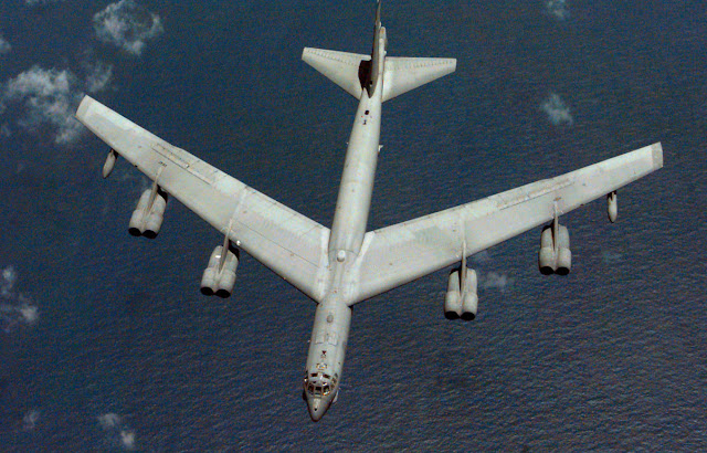 British Indian Island Territory -- A B-52H Stratofortress from the 96th Bomb Squadron from above over sea.
