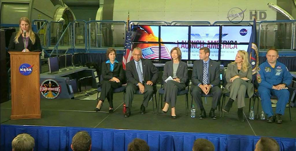 NASA's Stephanie Schierholz introduces the panel of Johnson Space Center Director Dr. Ellen Ochoa, seated, left, NASA Administrator Charles Bolden, Commercial Crew Program Manager Kathy Lueders, Boeing's Jon Elbon, SpaceX's Gwynne Shotwell and NASA astronaut Mike Fincke. Image Credit: NASA TV