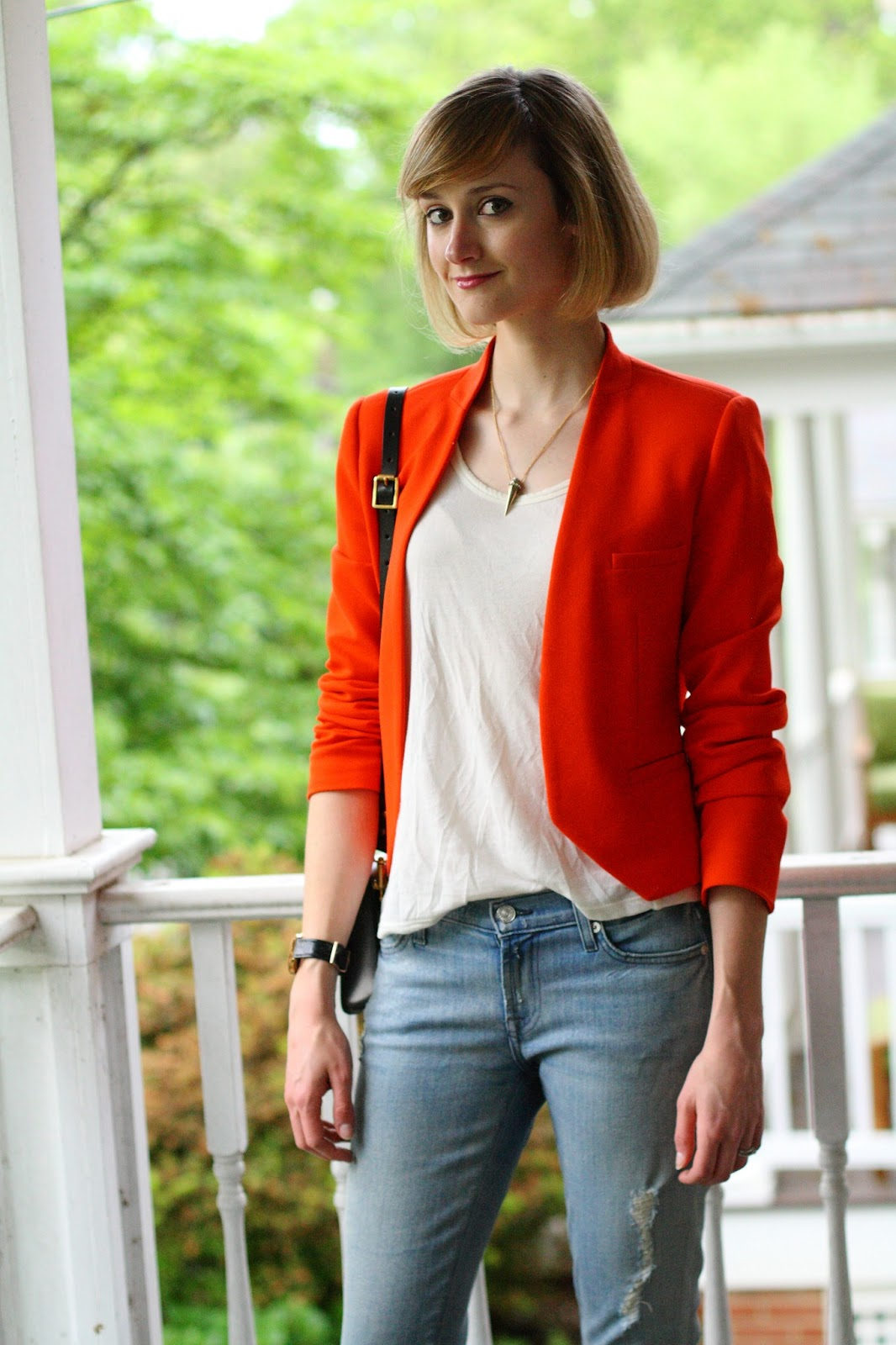 A.V. Max necklace, orange blazer, and distressed denim