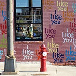 "A wall covered in the words ""I like you"""