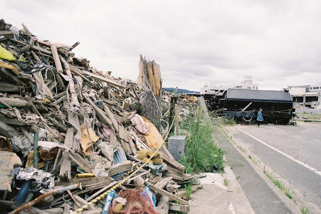 heaps of debris in minamisanriku