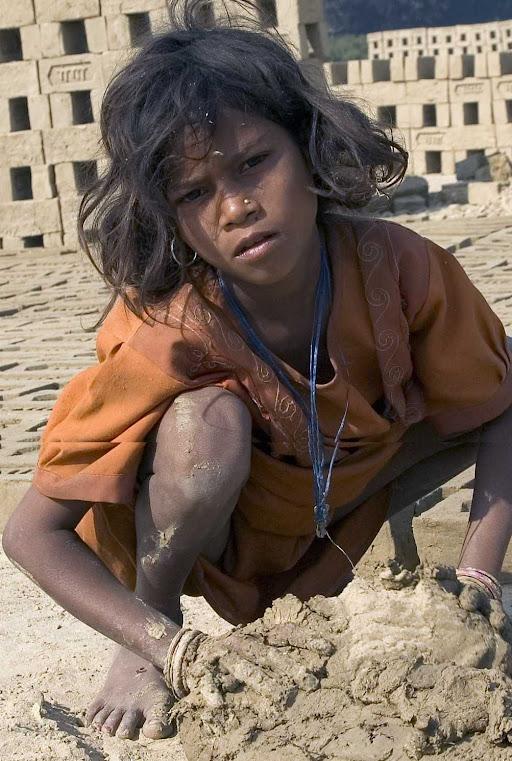 Slave girl making bricks