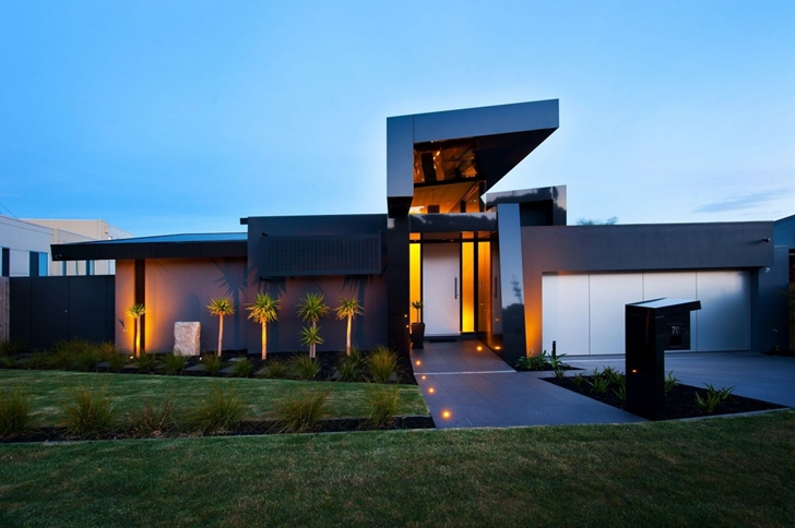 Modern street side facade on Dream home in black and blue