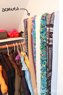 Scarves are stored on an empty wall inside the closet