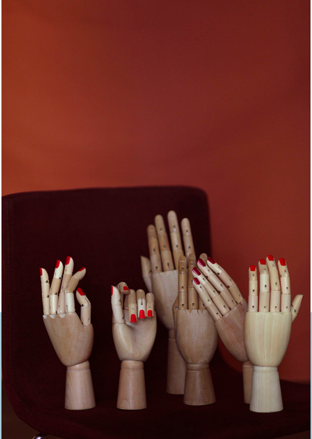 wooden mannequin hands with red nail polish