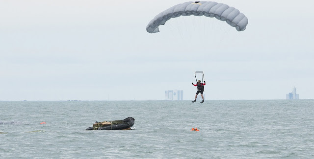 An Air Force Reserve pararescueman descends into the Atlantic Ocean from an Air Force C-17 Globemaster III in an effort to recover a NASA astronaut as part of an exercise Jan. 14 off the shore of Cape Canaveral Air Force Station, Florida. The 45th Operations Group Detachment 3 joined NASA's Commercial Crew Program and Air Force pararescuemen, combat rescue officers and survival, evasion, resistance and escape specialists to simulate to practice recovering astronauts quickly and safely in the event they would need to abort their spacecraft. The small Air Force detachment has served as the liaison between NASA's Johnson Space Center in Houston, Texas, the Air Force and Department of Defense for more than 55 years, training men and women of those organizations for launch contingencies and astronaut recovery. (U.S Air Force photo/Matthew Jurgens)