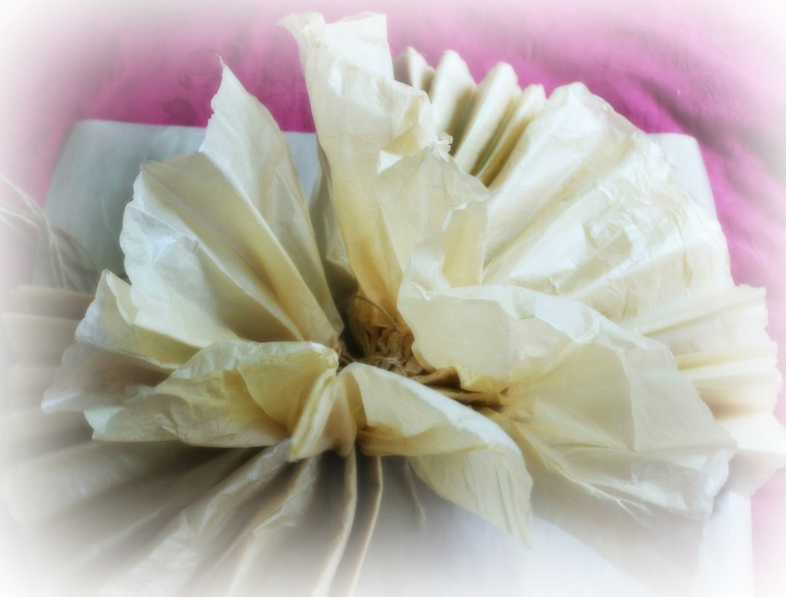 how to make tissue paper pom poms small These diy wedding paper pom poms are easy and inexpensive ways to spruce  up your  cut 5 pieces of tissue wrapping paper in the shape of a square.
