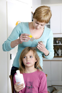 woman checking girl for lice