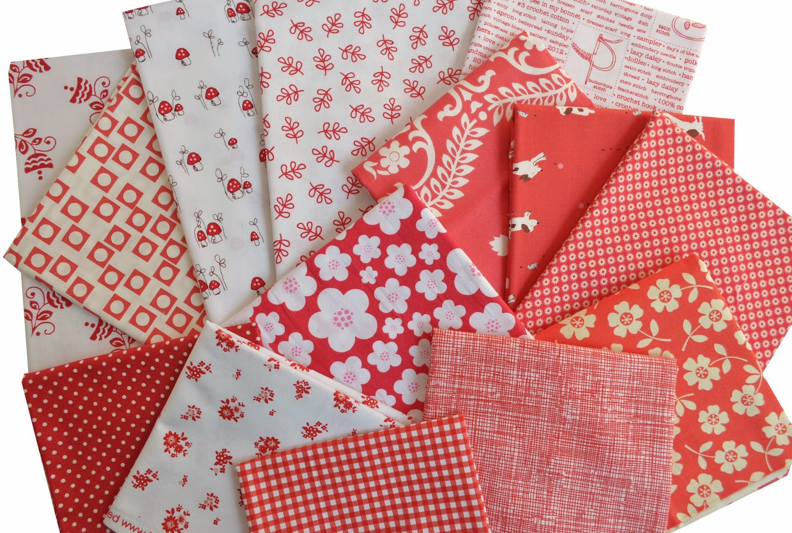 collage of red and white quilting cottons