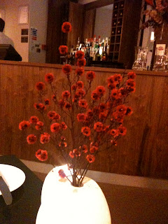 a vase of flowers in a restaurant in Edinburgh