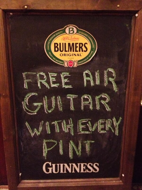 bar sign free air guitar with every pint