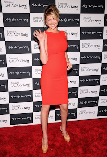 Kate Upton at Samsung Galaxy Note 10.1  Event red carpet wearing an orange dress