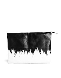 http://www.asos.com/Monki/Monki-Minna-Hug-Hold-Oversized-Clutch-Bag/Prod/pgeproduct.aspx?iid=3351302&cid=13506&sh=0&pge=9&pgesize=204&sort=-1&clr=Blk%2fwhi
