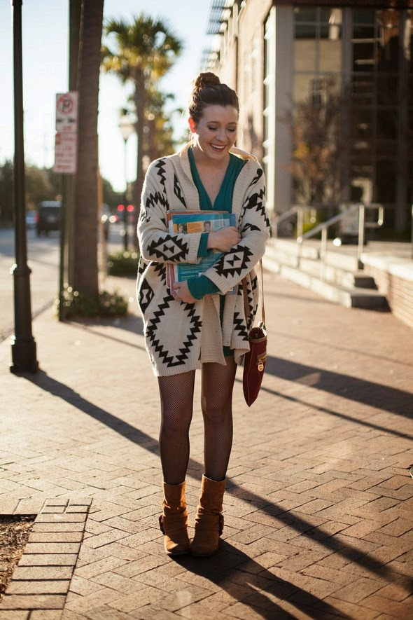 charleston street style black tights brown short boots top bun women smiling big sweater winter fashion southern fashion charleston sc the stylepreneur