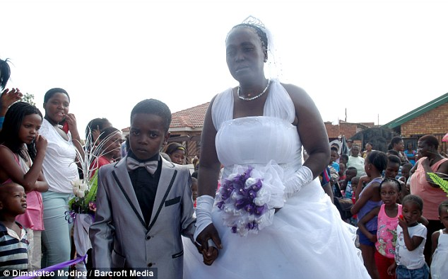 Eight-Year Old Sanele Masilela walks down the aisle with his 61-year-old bride Helen Shabangu at their wedding ceremony in Tshwane, South Africa.
