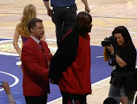 Will Ferrell escorts Shaquille O'Neal out of the Staples Center