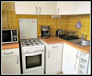 In a tiny kitchen, streamline as much as possible - appliances, color scheme, counter space, etc.