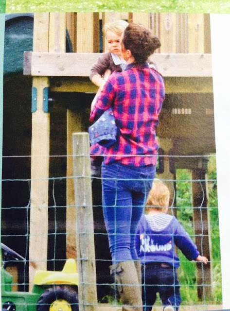 Kate Middleton and Prince George play with a toy tractor at Snettisham Park