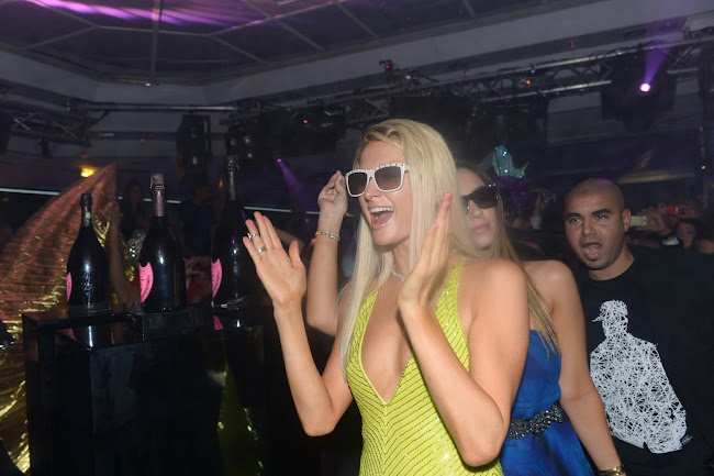 Paris Hilton having a good time at a nightclub in Cannes
