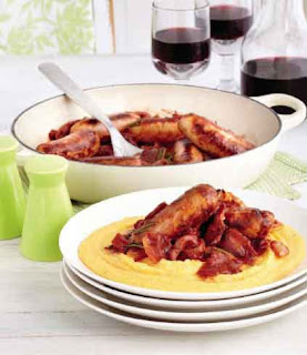 Braised Italian sausages with soft polenta